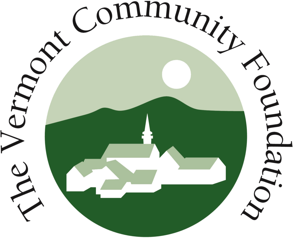 The logo of the Vermont Community Foundation with a village, moon and green mountains