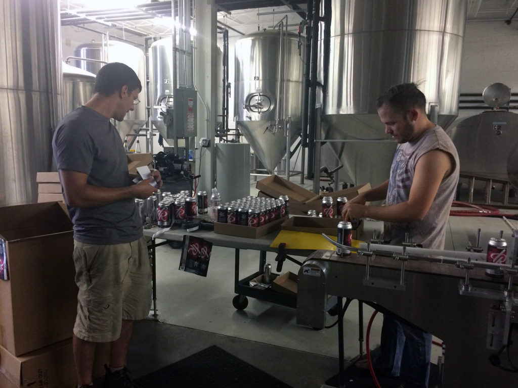 Two men working at a brewery